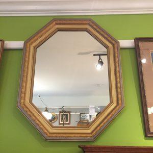 Vintage octagonal gilt framed mirror.