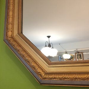 Frame detail on octagonal gilt mirror